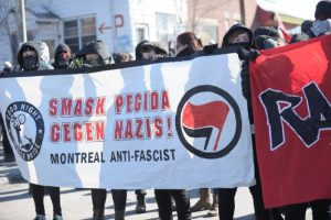 Canadian anti-Islamophobia demonstrators march in Montreal on March 28, 2015, against sympathizers of the German based anti-Islam group PEGIDA (Patriotic Europeans Against the Islamisation of the West) that were planning a rally against Muslims. PEGIDA cancelled their march after the large turnout against them. AFP PHOTO / MARC BRAIBANT